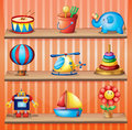 Toy collections that are properly arranged in the wooden shelves illustration of Stock Image