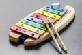 Toy colorful xylophone photo of a with sticks Royalty Free Stock Images