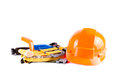 Toy construction helmet and tools over Royalty Free Stock Photo