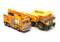 Toy crane and dump truck on white background Stock Photos