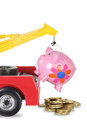 Toy crane and piggy bank on white background Stock Photos