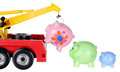 Toy crane and piggy banks on white background Stock Photography