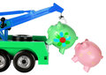 Toy crane and piggy banks on white background Royalty Free Stock Photos