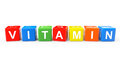 Toy cubes as vitamin sign on a white background Royalty Free Stock Photos