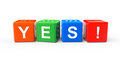 Toy cubes as yes sign on a white background Stock Photos