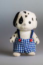 Toy daddy dog made from plush with suspenders Stock Image