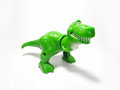 Toy dinosaur green white background white Stock Photos