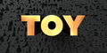 Toy - Gold text on black background - 3D rendered royalty free stock picture