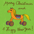 Toy horse greetings card vintage for christmas and the new year s eve hand drawn illustratiion and text over a green grungy Royalty Free Stock Photo