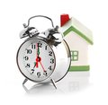 Toy House and alarm clock Stock Images