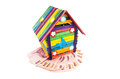 Toy house colorful with money isolatd on white background Royalty Free Stock Photos
