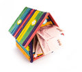 Toy house colorful with money isolatd on white background Stock Photos