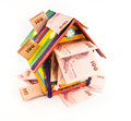 Toy house colorful with money isolatd on white background Royalty Free Stock Photo