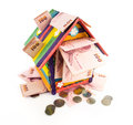 Toy house colorful with money isolatd on white background Stock Photography