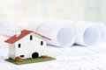 Toy house with house plans close up of small on architectural blueprints Stock Image