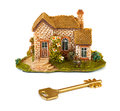 Toy house and key on white background Stock Photo