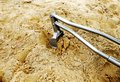 Toy metal excavator on the playground in the sand