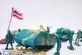 Toy military convoy on light gray background Royalty Free Stock Image