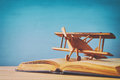 Toy plane and the open book on wooden table Royalty Free Stock Photo