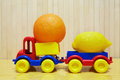 Toy plastic car with lemon and orange Royalty Free Stock Photo