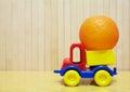 Toy plastic car with orange Royalty Free Stock Photo