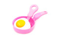 Toy plastic pan with spade of frying pan Royalty Free Stock Photo