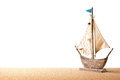 Toy sailboat on sand Stock Images