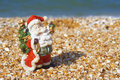 Toy Santa Claus at the beach Stock Image