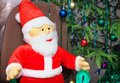 Toy santa claus near a christmas tree Royalty Free Stock Images