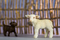 Toy sheep and shepherd with fences behind Royalty Free Stock Photos