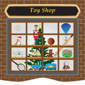 Toy shop a window at christmas with train soldier drum airplane football ship teddy bear rabbit cricket bat tennis raquet and Stock Photography