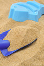 Toy shovel and sand mould Royalty Free Stock Photo