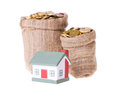 Toy small house and bags with money the concept of purchase of habitation Royalty Free Stock Photography