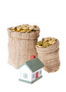 Toy small house and bags with money the concept of purchase of habitation Royalty Free Stock Image