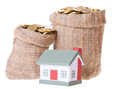 Toy small house and bags with money the concept of purchase of habitation Stock Image