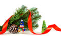 Toy snowman under a branch of an artificial Christmas tree with the cone Royalty Free Stock Photo