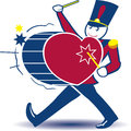 Toy soldier marching while beating a heart shaped drum Royalty Free Stock Image