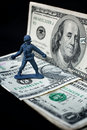 Toy soldier standing with dollar and weapons Stock Photos