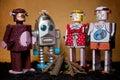 Toy tin robot gathering on brown background Stock Photo