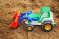 Toy tractor in the sandbox Stock Images