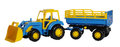 Toy tractor with a trailer Royalty Free Stock Photo