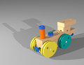 Toy train engine wooden steam with colored wheels casting a shadow Stock Photography