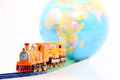 Toy train and globe on white background Stock Photo
