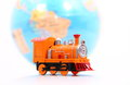 Toy train and globe on white background Stock Photography