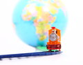 Toy train and globe on white background Stock Photos
