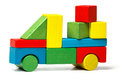 Toy truck multicolor car wooden blocks transportation cargo delivery over white background Royalty Free Stock Images