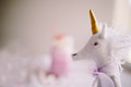 Toy unicorn on backgound of pink milk shake. Royalty Free Stock Photo