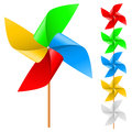 Toy windmill propeller set with multicolored blades on a white Stock Photos