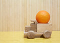 Toy wooden car with orange Royalty Free Stock Photo
