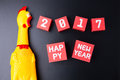 Toy yellow shrilling chicken and Happy new year 2017 number on r Royalty Free Stock Photo